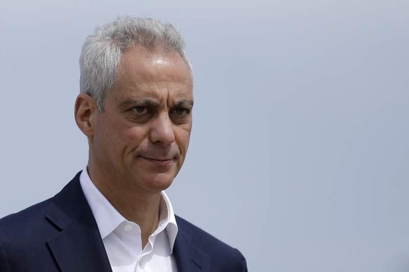FILE - In this April 22, 2019, file photo, Chicago Mayor Rahm Emanuel waves as he arrives at a news conference outside of the south air traffic control tower at O'Hare International Airport in Chicago. (AP Photo/Kiichiro Sato, File)