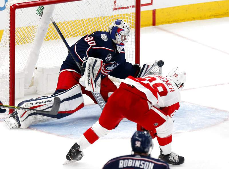 Detroit Red Wings forward Sam Gagner, right, scores past Columbus Blue Jackets goalie Matiss Kivlenieks during the third period of an NHL hockey game in Columbus, Ohio, Saturday, May 8, 2021. (AP Photo/Paul Vernon)