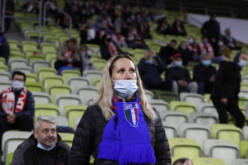 An Italian fan wears a protective mask attends the UEFA Nations League soccer match between Poland and Italy at Energa stadium in Gdansk, Poland, Sunday, Oct. 11, 2020. (AP Photo/Czarek Sokolowski)