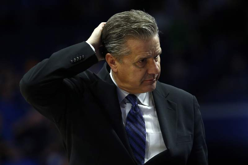 Kentucky coach John Calipari scratches his head late in the second half of the team's NCAA college basketball game against Tennessee, Tuesday, March 3, 2020, in Lexington, Ky. Tennessee won 81-73. (AP Photo/James Crisp)