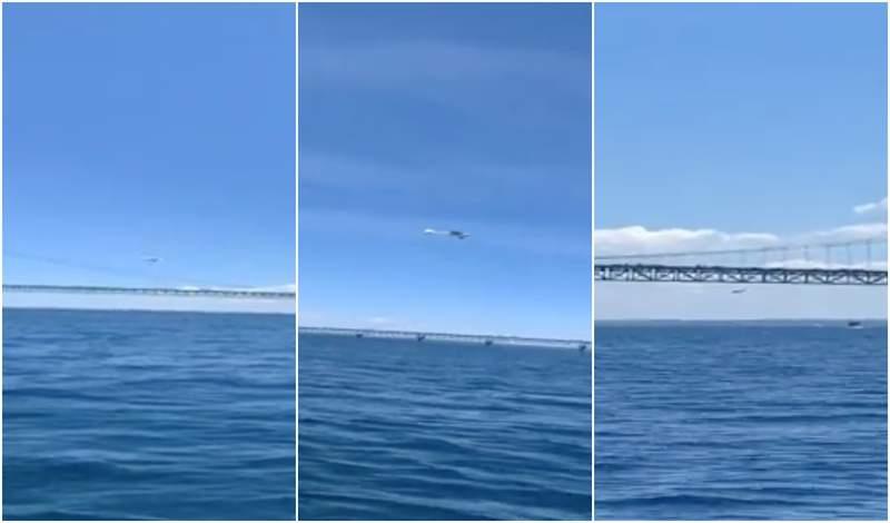 Video shows small plane flying under Mackinac Bridge.