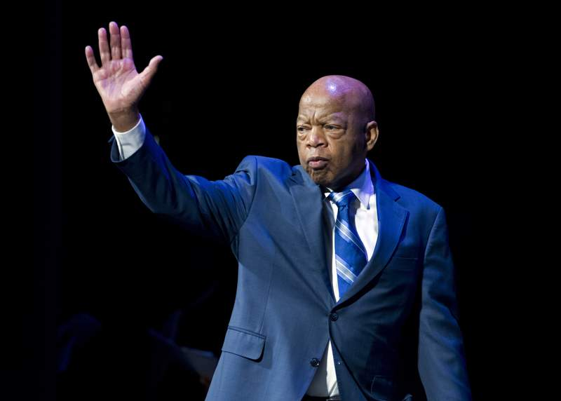 FILE- In this Jan. 3, 2019, file photo, Rep. John Lewis, D-Ga., waves to the audience during swearing-in ceremony of Congressional Black Caucus members of the 116th Congress in Washington. The NAACP is honoring Lewis for his Congressional service and long history as a civil rights activist. (AP Photo/Jose Luis Magana, File)