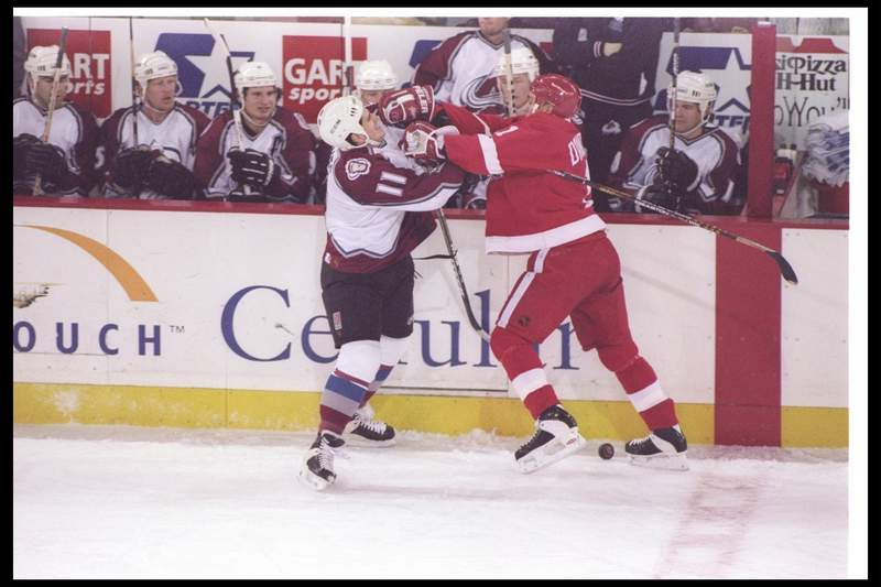 17 Dec 1996: Rightwinger Keith Jones of the Colorado Avalanche (left) and Detroit Red Wings rightwinger Mathieu Dandenault tangle up during a game at McNichols Arena in Denver, Colorado. The Avalanche won the game, 4-3.