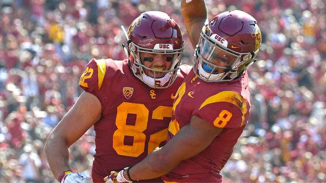 Wide receiver Amon-Ra St. Brown #8 celebrates with tight end Tyler Petite #82 of the USC Trojans after scoring a touchdown in the fourth quarter of the game against the UNLV Rebels at the Los Angeles Memorial Coliseum on September 1, 2018 in Los Angeles, California. (Photo by Jayne Kamin-Oncea/Getty Images)