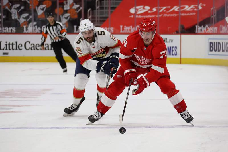 DETROIT, MICHIGAN - JANUARY 30: Dylan Larkin #71 of the Detroit Red Wings skates against the Florida Panthers at Little Caesars Arena on January 30, 2021 in Detroit, Michigan. (Photo by Gregory Shamus/Getty Images)