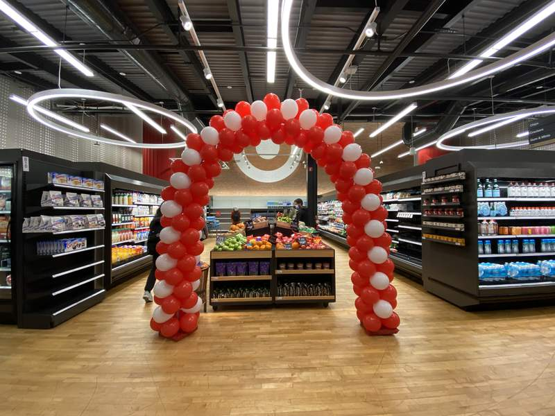 An archway of balloons stands next to the produce section at the brand-new Target store in downtown Ann Arbor on Sept. 22, 2021.