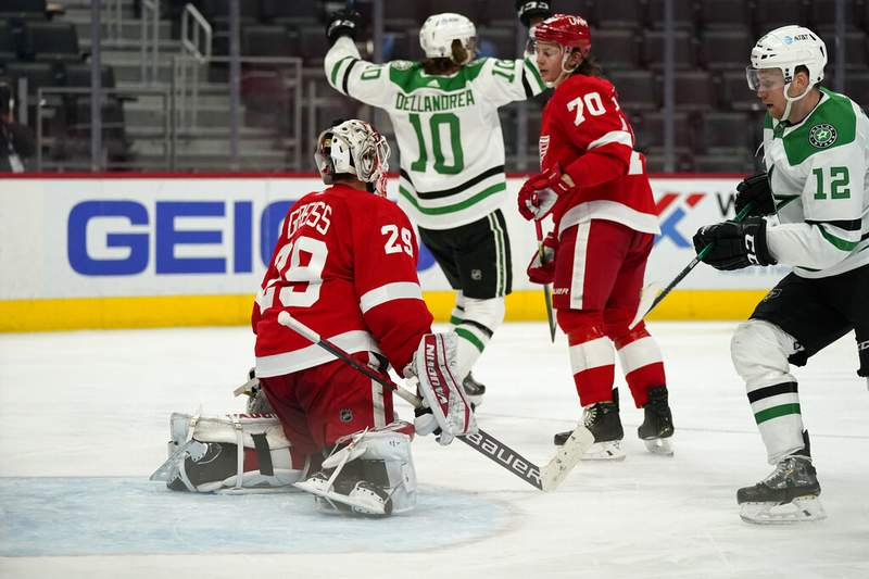 Dallas Stars' Ty Dellandrea reacts after scoring a goal on Detroit Red Wings goaltender Thomas Greiss (29) during the third period of an NHL hockey game, Saturday, March 20, 2021, in Detroit. (AP Photo/Carlos Osorio)