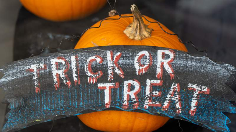 Generic trick or treat sign on a pumpkin