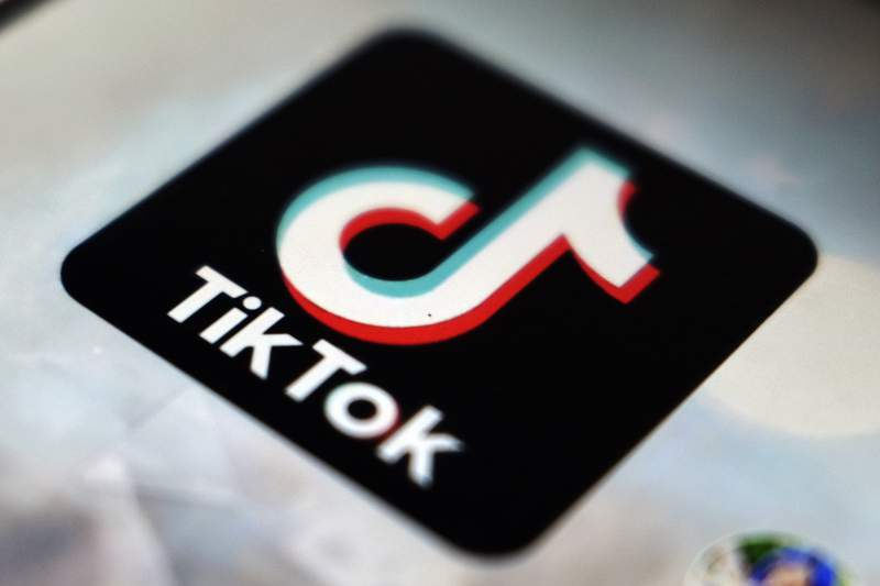 FILE - In this Monday, Sept. 28, 2020 filer, a logo of a smartphone app TikTok is seen on a user post on a smartphone screen, in Tokyo. TikTok is facing two EU data privacy investigations, one into its handling of children's personal data and another over its data transfers to China. Ireland's data privacy watchdog, which is TikTok's lead regulator in the European Union, said Tuesday that it has started two inquiries to examine whether the popular short video app has breached stringent EU data privacy regulations. (AP Photo/Kiichiro Sato, File)