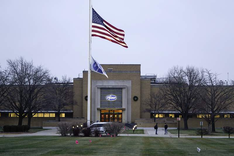 The Pfizer Global Supply Kalamazoo manufacturing plant is shown in Portage, Mich., Friday, Dec. 11, 2020. The U.S. gave the final go-ahead Friday to the nations first COVID-19 vaccine, marking what could be the beginning of the end of an outbreak that has killed nearly 300,000 Americans. (AP Photo/Paul Sancya)
