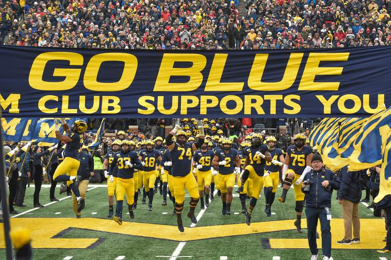 The Michigan Wolverines football team takes the field before a college football game against the Ohio State Buckeyes at Michigan Stadium on November 30, 2019 in Ann Arbor, MI.