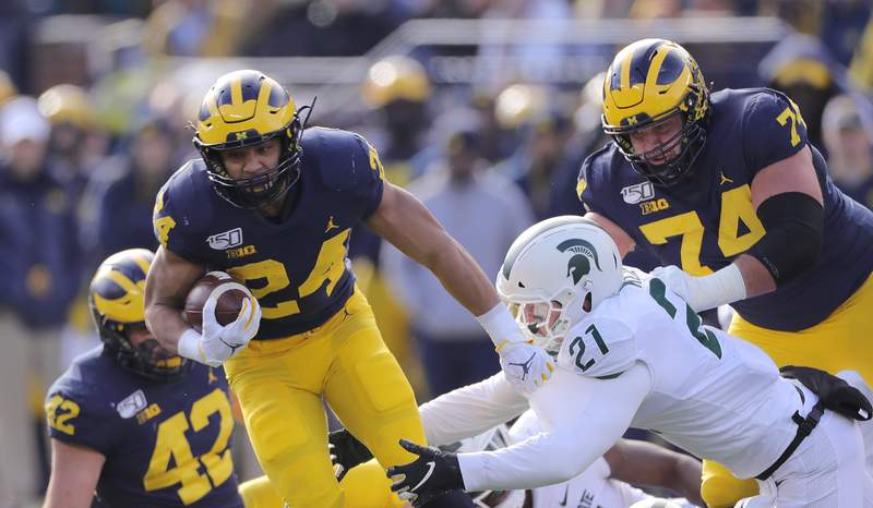 Zach Charbonnet #24 of the Michigan Wolverines runs for a first down during the third quarter of the game against the Michigan State Spartans at Michigan Stadium on November 16, 2019 in Ann Arbor, Michigan. Michigan defeated Michigan State 44-10. (Photo by Leon Halip/Getty Images)