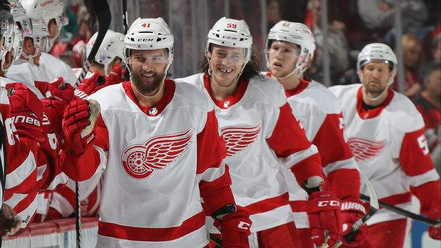 Luke Glendening of the Detroit Red Wings (l) celebrates his goal. (Photo by Bruce Bennett/Getty Images)