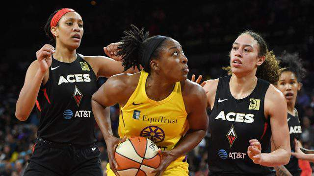 LAS VEGAS, NEVADA - MAY 26: Nneka Ogwumike #30 of the Los Angeles Sparks drives to the basket against A'ja Wilson (L) #22 and Dearica Hamby #5 of the Las Vegas Aces during their game at the Mandalay Bay Events Center on May 26, 2019 in Las Vegas, Nevada. (Photo by Ethan Miller/Getty Images )