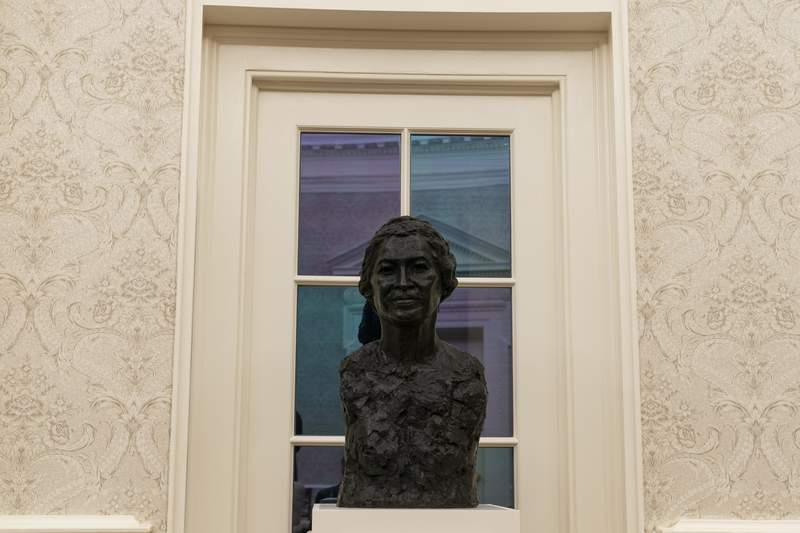 The Oval Office of the White House is newly redecorated for the first day of President Joe Biden's administration, Wednesday, Jan. 20, 2021, in Washington, including a bust of civil rights leader Rosa Parks. (AP Photo/Alex Brandon)