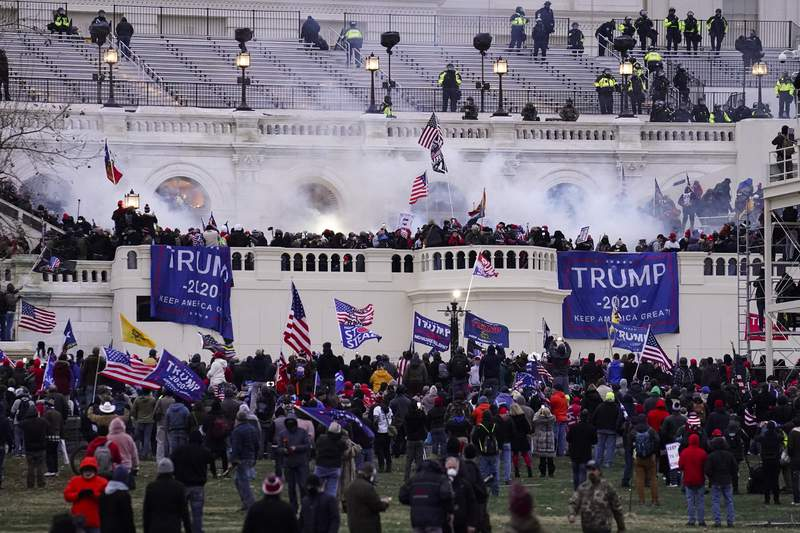 FILE - In this Jan. 6, 2021, file photo, violent rioters storm the Capitol, in Washington. The horror of Jan. 6 has been reduced from a stunning assault on American democracy to another political fight. Rather than unite behind a bipartisan investigation like the one that followed the Sept. 11, 2001, terror attacks, Republicans are betting they can regain at least partial control of Congress if they put the issue behind them as quickly as possible without antagonizing former President Donald Trump or his supporters. (AP Photo/John Minchillo, File)