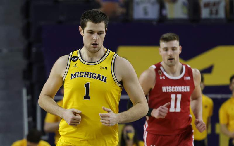 Hunter Dickinson #1 of the Michigan Wolverines runs down the court after scoring during the second half of the game against the Wisconsin Badgers at Crisler Arena on January 12, 2021 in Ann Arbor, Michigan. Michigan defeated Wisconsin 77-54.