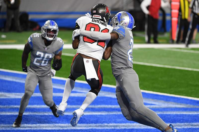 Antonio Brown #81 of the Tampa Bay Buccaneers makes a reception for a touchdown ahead of Justin Coleman #27 of the Detroit Lions during the second quarter of a game at Ford Field on December 26, 2020 in Detroit, Michigan.
