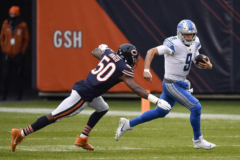 Matthew Stafford #9 of the Detroit Lions is tackled by Barkevious Mingo #50 of the Chicago Bears during the first half at Soldier Field on December 06, 2020 in Chicago, Illinois.