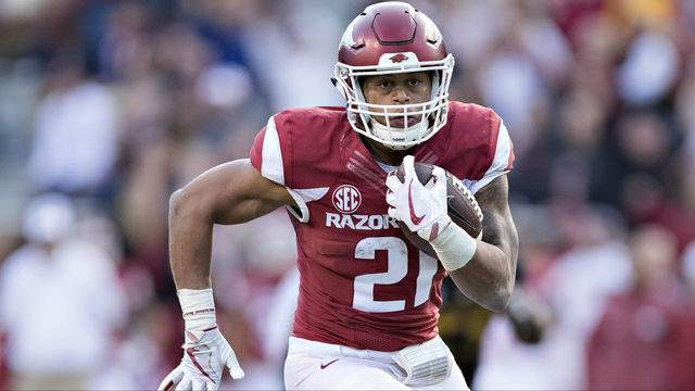Devwah Whaley #21 of the Arkansas Razorbacks runs the ball for a touchdown during a game against the Missouri Tigers at Razorback Stadium on November 24, 2017 in Fayetteville, Arkansas. The Tigers defeated the Razorbacks 48-45. (Photo by Wesley Hitt/Getty Images)