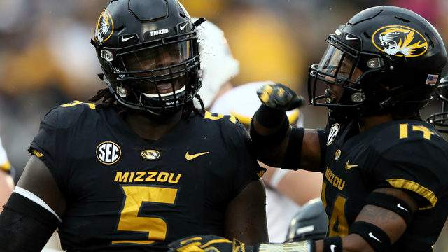 Defensive back Adam Sparks #14 of the Missouri Tigers congratulates defensive lineman Terry Beckner Jr. #5 after a tackle during the game against the Wyoming Cowboys at Faurot Field/Memorial Stadium on September 8, 2018 in Columbia, Missouri. (Photo by Jamie Squire/Getty Images)