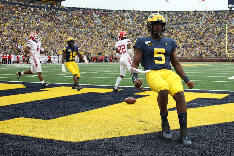 Joe Milton #5 of the Michigan Wolverines scores a fourth quarter touchdown while playing the Rutgers Scarlet Knights at Michigan Stadium on September 28, 2019 in Ann Arbor, Michigan.