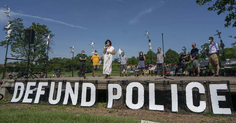 """Alondra Cano, a City Council member, speaks during """"The Path Forward"""" meeting at Powderhorn Park on Sunday, June 7, 2020, in Minneapolis. The focus of the meeting was the defunding of the Minneapolis Police Department. (Jerry Holt/Star Tribune via AP)"""