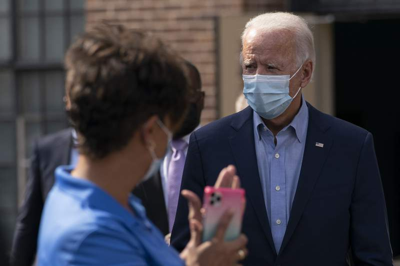 Democratic presidential candidate former Vice President Joe Biden is applauded as he arrives to pose for a photo with union leaders outside the AFL-CIO headquarters in Harrisburg, Pa., Monday, Sept. 7, 2020. (AP Photo/Carolyn Kaster)