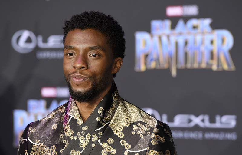 "FILE - In this Jan. 29, 2018 file photo, Chadwick Boseman, a cast member in ""Black Panther,"" poses at the premiere of the film in Los Angeles. Boseman, who played Black icons Jackie Robinson and James Brown before finding fame as the regal Black Panther in the Marvel cinematic universe, died of colon cancer on Aug. 28, 2020 in Los Angeles. He was buried on Sept. 3, in Belton, South Carolina, about 11 miles from his hometown of Anderson, according to a death certificate obtained Monday, Sept. 14  by The Associated Press. (Photo by Chris Pizzello/Invision/AP, File)"