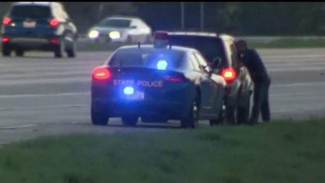 Michigan State Police trooper conducts traffic stop. (WDIV)