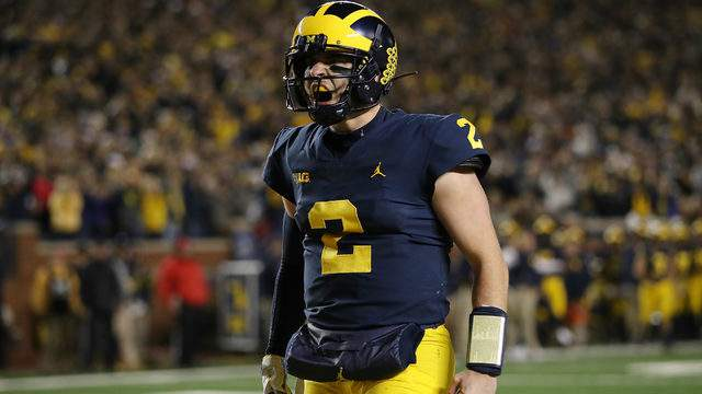 Shea Patterson reacts to a a Karan Higdon touchdown while playing Wisconsin on Oct. 13, 2018, at Michigan Stadium in Ann Arbor. (Gregory Shamus/Getty Images)