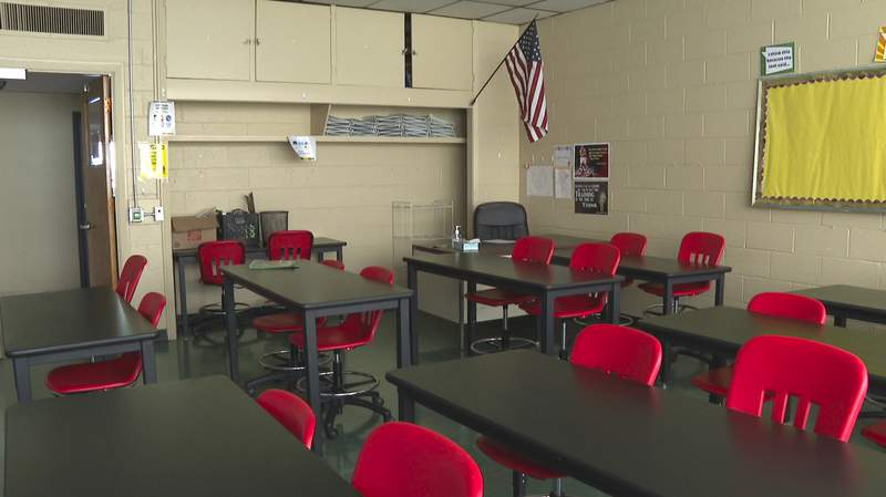In this image made from video, an empty classroom is shown at David Ellis Academy in Detroit, Monday, Feb. 8, 2021. It's coming up on a year since most of the students at the pre-K through 8th grade public charter school last had an in-person school day. (AP Photo/Mike Householder)