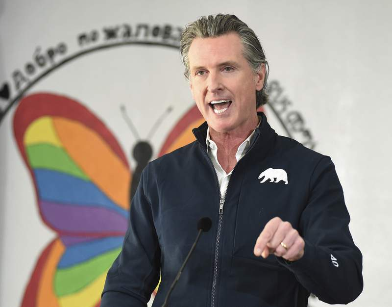 FILE - In this Feb. 26, 2021 file photo California Gov. Gavin Newsom speaks during a press conference after visiting a COVID-19 vaccination clinic for farmworkers at the Dr. Sharon Stanley-Rea Community Center in Fresno, Calif. The annual State of the State address Newsom will deliver on Tuesday, March 9, 2021, will be one of the most important speeches of his political career. It comes about a year after his first coronavirus stay-at-home order and as he faces a potential recall election. (John Walker/The Fresno Bee via AP, Pool, File)