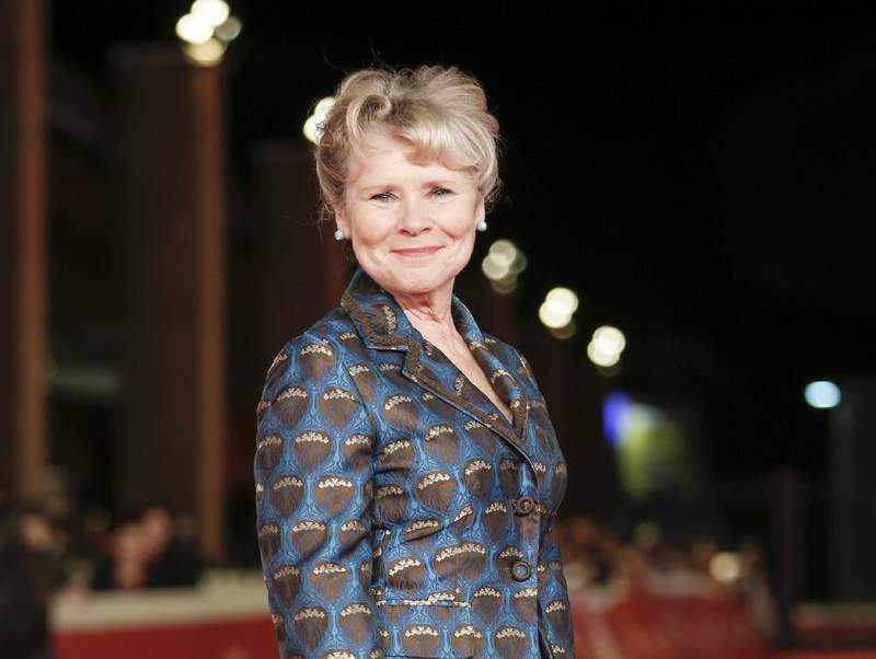 """FILE - This Oct. 19, 2019 file photo shows actress Imelda Staunton on the red carpet for the movie """"Downton Abbey"""" at the Rome Film Fest in Rome. Staunton has been tapped to be the last actress to play Queen Elizabeth II in the Netflix series """"The Crown.""""  She will take the crown in the fifth and final season of the series. (AP Photo/Domenico Stinellis, File)"""