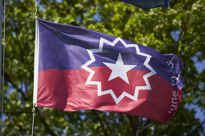 The Juneteenth flag, commemorating the day that slavery ended in the U.S., flies in Omaha, Nebraska, on Wednesday, June 17, 2020.