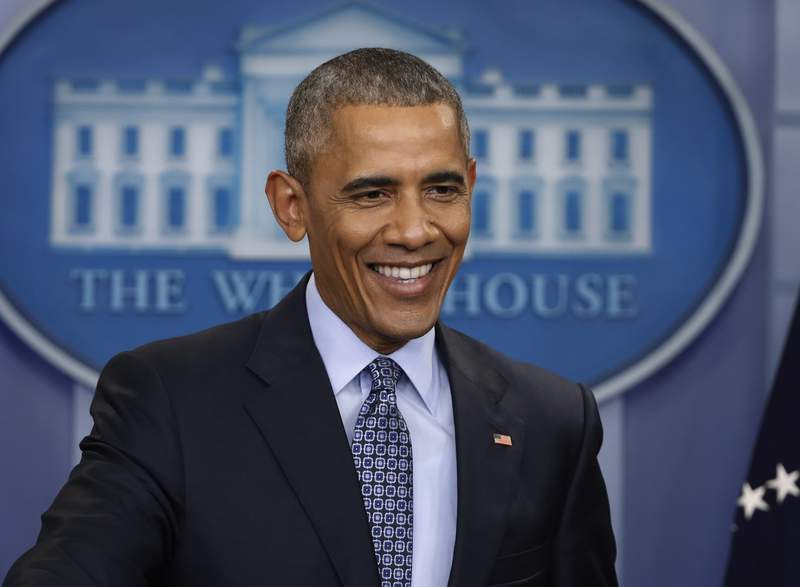 FILE - In this Jan. 18, 2017 file photo, President Barack Obama smiles during his final presidential news conference in the briefing room of the White House in Washington. More than a dozen 60 Minutes interviews with Obama, beginning when he was a U.S. Senator, have been compiled into an audio release, Barack Obama: The 60 Minutes Interviews coming out Oct. 13. (AP Photo/Pablo Martinez Monsivais, File)