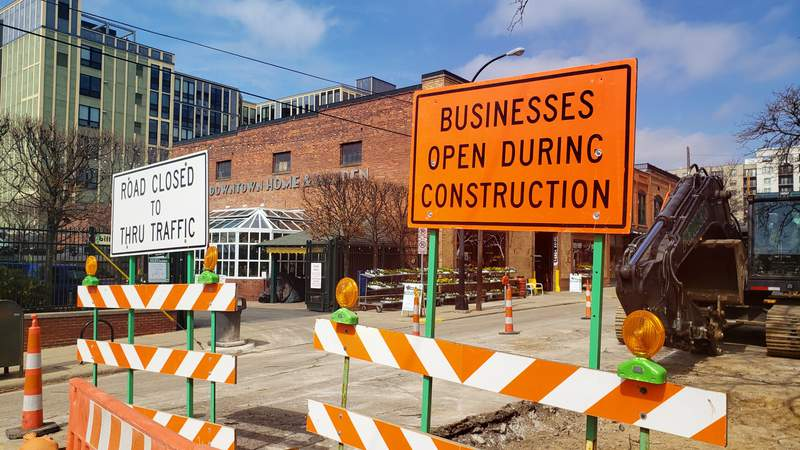 Road closed signs on South Ashley Street in downtown Ann Arbor in March, 2021.