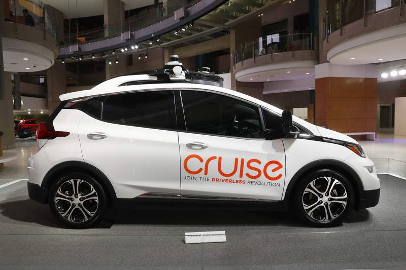 FILE - In this Jan. 16, 2019, file photo, Cruise AV, General Motor's autonomous electric Bolt EV is displayed in Detroit. General Motors' self-driving car company is sending vehicles without anybody behind the wheel in San Francisco as it navigates its way toward launching a robotic taxi service that would compete against Uber and Lyft in the hometown of the leading ride-hailing services. The move announced Wednesday, Dec. 9, 2020, by GM-owned Cruise come two months after the company received Californias permission to fully driverless cars in the state.  (AP Photo/Paul Sancya, File)