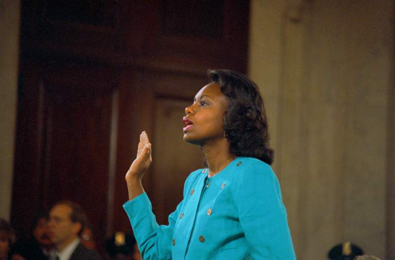 Washington: Professor Anita Hill is sworn-in before testifying at the Senate Judiciary hearing on the Clarence Thomas Supreme Court nomination. Miss Hill testified on her charges of alleged sexual harassment by Judge Thomas in 1991.