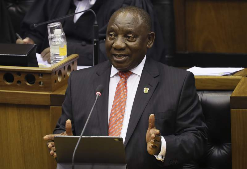 FILE  In this Thursday, Feb. 13, 2020 file photo, South African President Cyril Ramaphosa delivers his State of the Nation Address in Cape Town, South Africa.  Ramaphosa on Thursday Aug. 27, 2020, faced tough questioning by lawmakers over COVID-19 corruption allegations, days after he asked ruling party members to refrain from stealing money meant for the poor. (Sumaya Hisham/Pool Photo via AP, File)