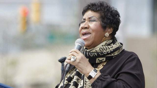 Singer Aretha Franklin performs during a Labor Day event on September 5, 2011 in Detroit. Franklin entertained the crowd as they awaited President Barack Obama's Labor Day address. (Photo by Bill Pugliano/Getty Images)