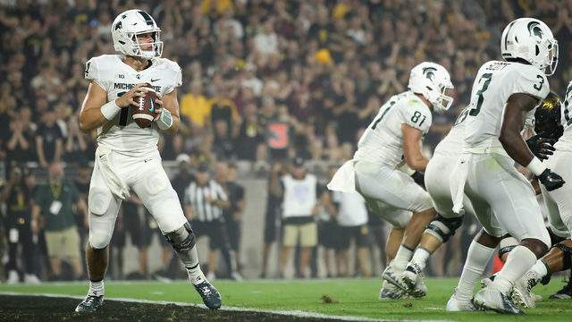 Quarterback Brian Lewerke #14 of the Michigan State Spartans drops back to pass during the first half of the college football game against the Arizona State Sun Devils at Sun Devil Stadium on September 8, 2018 in Tempe, Arizona. The Sun Devils defeated the Spartans 16-13. (Photo by Christian Petersen/Getty Images)