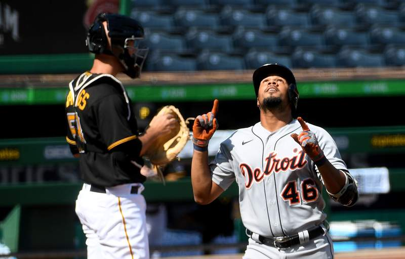 PITTSBURGH, PA - AUGUST 08: Jeimer Candelario #46 of the Detroit Tigers points to the sky as he crosses home plate after hitting a solo home run in the first inning during the game against the Pittsburgh Pirates at PNC Park on August 8, 2020 in Pittsburgh, Pennsylvania. (Photo by Justin Berl/Getty Images)