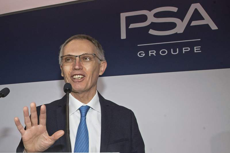 FILE - In this Feb. 26, 2020 file photo, CEO of PSA Groupe Carlos Tavares arrives for the presentation of the company's 2019 full year results in Rueil-Malmaison, west of Paris.  Stellantis is a little late to the global electric vehicle party, but on Thursday, July 8, 2021, it pledged to catch up and pass its competitors.  Tavares says that by 2025, 98 percent of its models in Europe and North America will have electric versions.   (AP Photo/Michel Euler, File)
