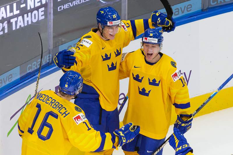 EDMONTON, AB - DECEMBER 26: Theodor Niederbach #16, Elmer Soderblom #25 and Lucas Raymond #18 of Sweden celebrate a goal against the Czech Republic during the 2021 IIHF World Junior Championship at Rogers Place on December 26, 2020 in Edmonton, Canada. (Photo by Codie McLachlan/Getty Images)
